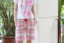 With floral printed t-shirt and pale pink sandals