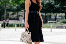 With gray embellished bag and black lace up platform sandals
