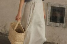 With gray linen loose shirt, straw tote bag and brown leather low heeled sandals