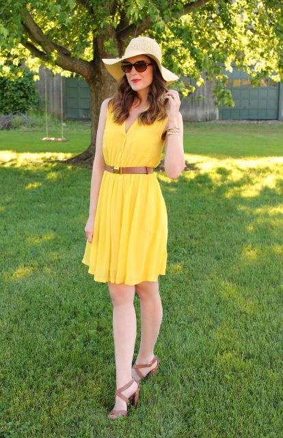 With hat and brown leather heeled sandals