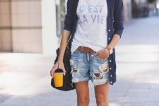 With labeled t-shirt, navy blue long cardigan, black bag and white sneakers