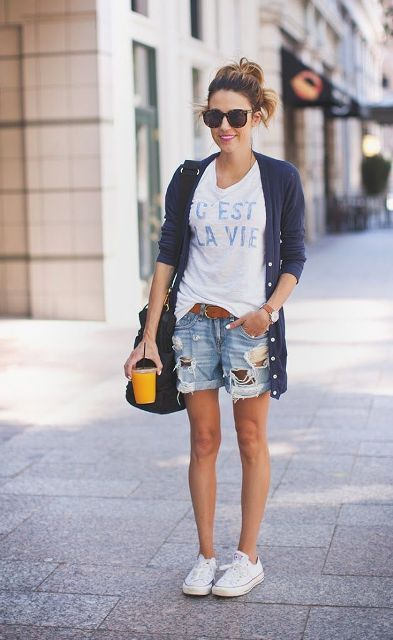 With labeled t shirt, navy blue long cardigan, black bag and white sneakers
