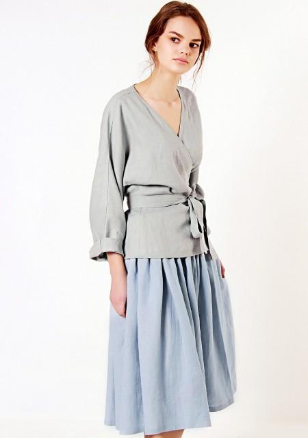 With light blue midi skirt
