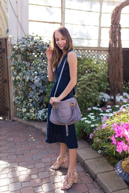 With lilac bag and pale pink tassel sandals
