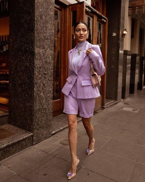 With lilac turtleneck, pale pink bag and transparent embellished shoes