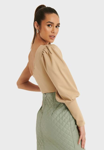 With mint green high waisted skirt