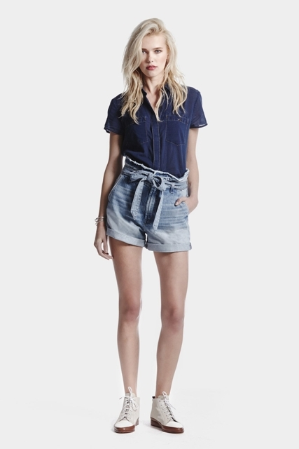 With navy blue denim shirt and gray and white lace up shoes