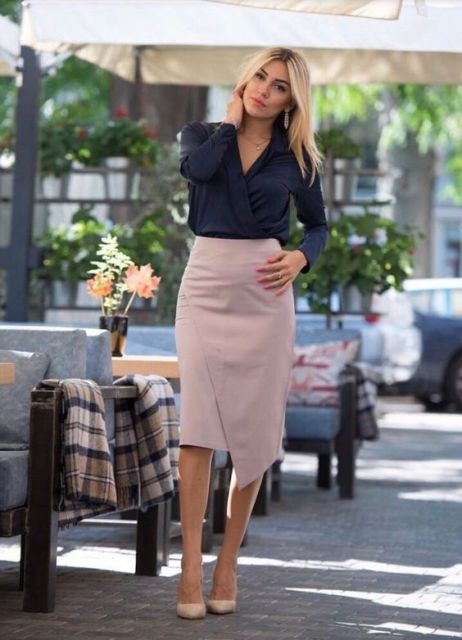 With navy blue wrap blouse and beige pumps