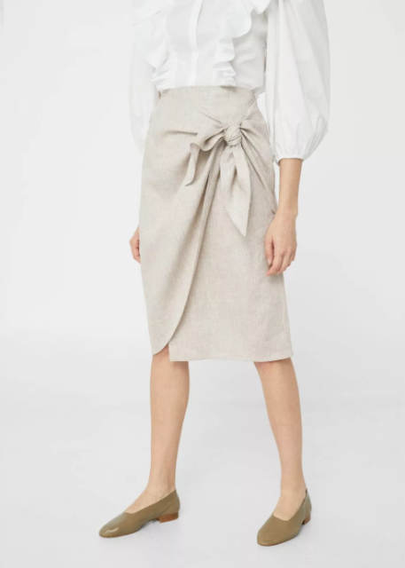 With olive green flat shoes and white ruffled blouse