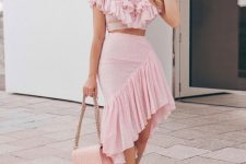 With pale pink ruffled crop blouse, pale pink chain strap bag and white pumps