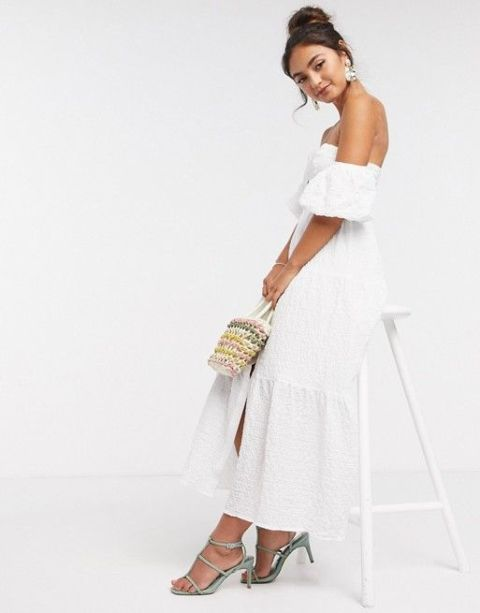 With pastel colored bag and gray heeled sandals