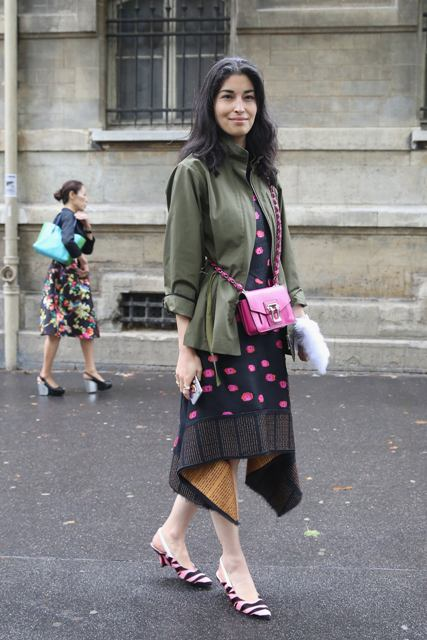 With printed asymmetrical dress, olive green jacket and pink bag
