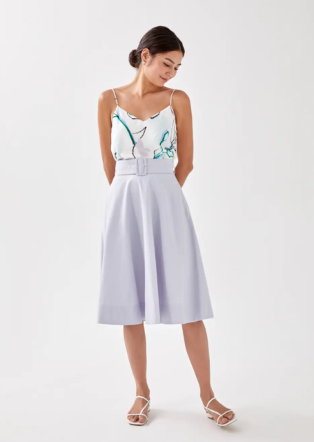 With printed sleeveless top and white flat sandals