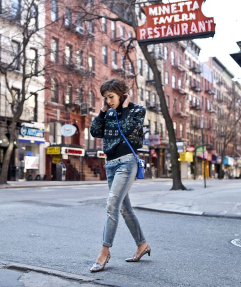 With printed sweater, distressed cuffed jeans and cobalt blue crossbody bag