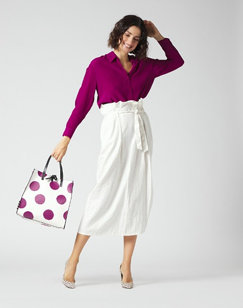 With purple button down shirt, polka dot tote bag and polka dot pumps