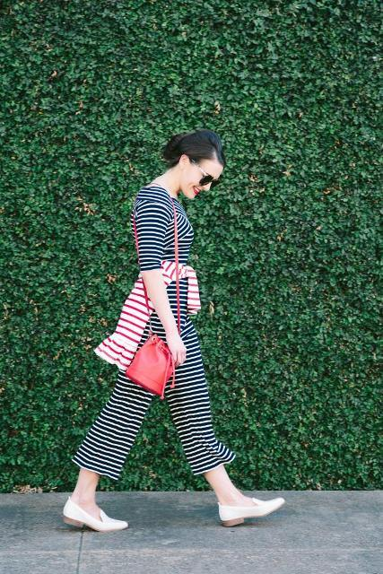 With red leather bag, white and red striped sweater and white flat shoes