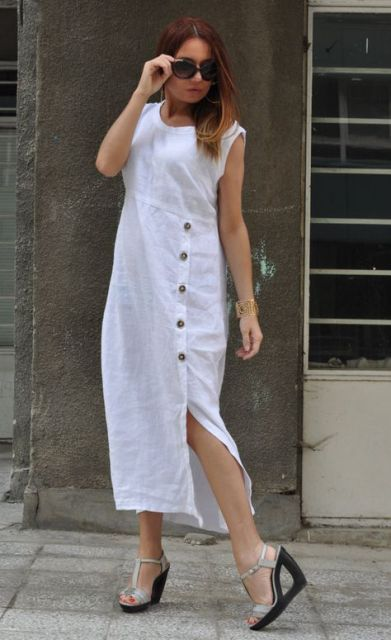 With silver ankle strap sandals and sunglasses