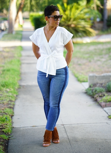 With skinny jeans and brown fringe cutout shoes
