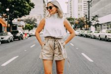 With sleeveless blouse and beige high heels