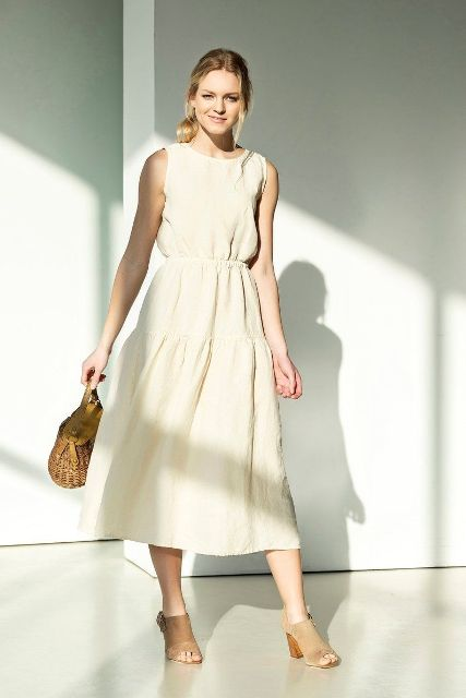 With straw bag and beige cutout sandals