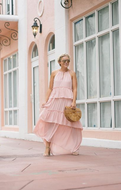 With straw bag and beige high heels