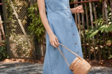 With straw bag and white flat sandals