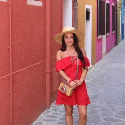 With straw hat and crossbody bag