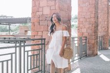 With straw rounded bag and beige ankle strap sandals