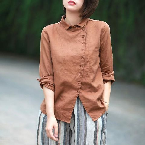 With striped linen trousers