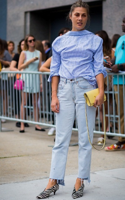 With striped shirt, light blue jeans and yellow leather bag