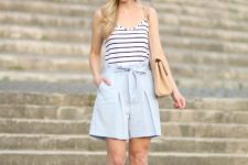 With striped sleeveless top, beige bag and beige cutout sandals