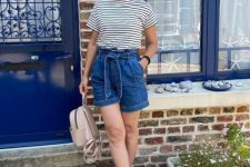 With striped t-shirt, beige leather backpack and white and navy blue striped flat shoes