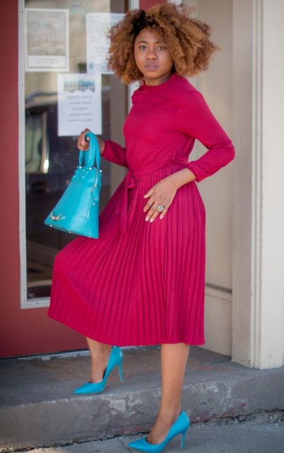 With turquoise pumps and leather bag