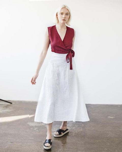 With white A-line midi skirt and black leather flat sandals