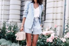 With white V-neck shirt, striped blazer, beige bag and lace up shoes