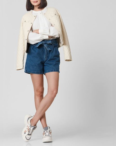 With white blouse, beige jacket and gray, pale pink and white sneakers