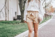 With white button down shirt, chain strap bag and cutout sandals