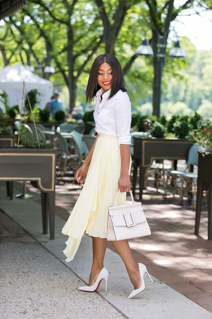 With white button down shirt, white tote bag and white pumps