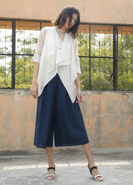 With white cardigan and black and white sandals