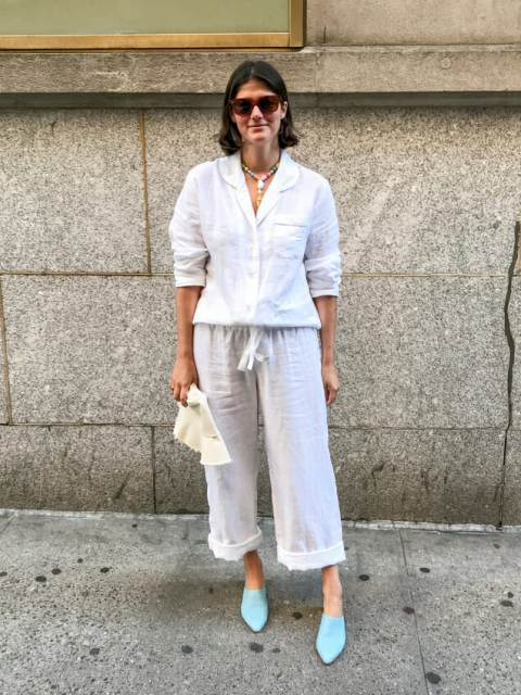 With white cardigan and light blue heeled mules