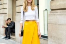 With white crop shirt, black mini bag and black leather flat sandals