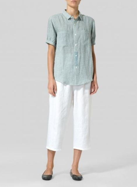 With white culottes and black flat shoes