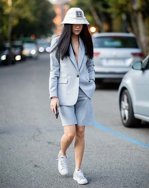With white hat and white sneakers