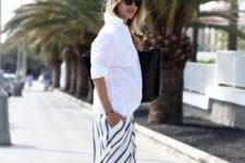 With white loose shirt and leopard printed flat shoes