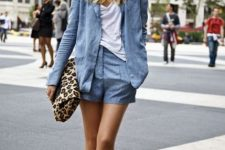With white loose t-shirt, leopard printed clutch and white and black sneakers
