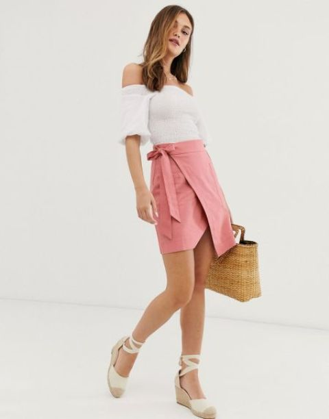 With white off the shoulder blouse, straw bag and beige lace up shoes