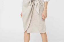 With white ruffled blouse and olive green flat shoes