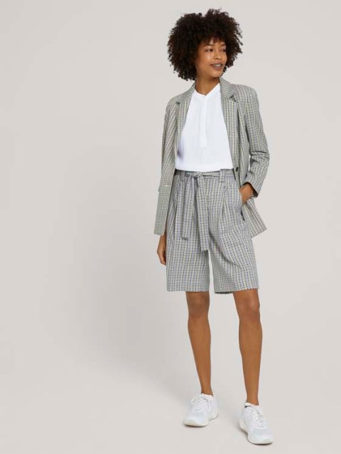 With white shirt, gray checked blazer and white sneakers