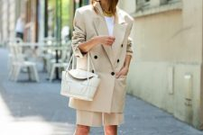 With white shirt, white bag and turquoise mules