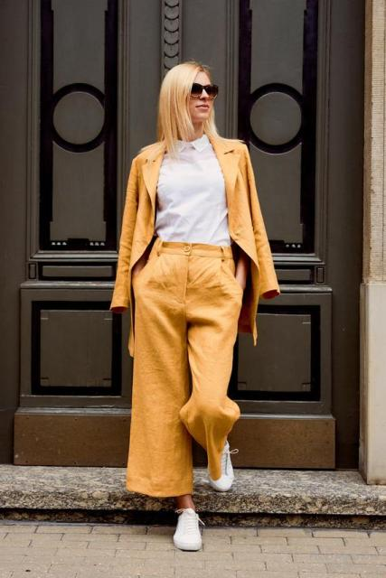 With white shirt, yellow linen blazer and white sneakers